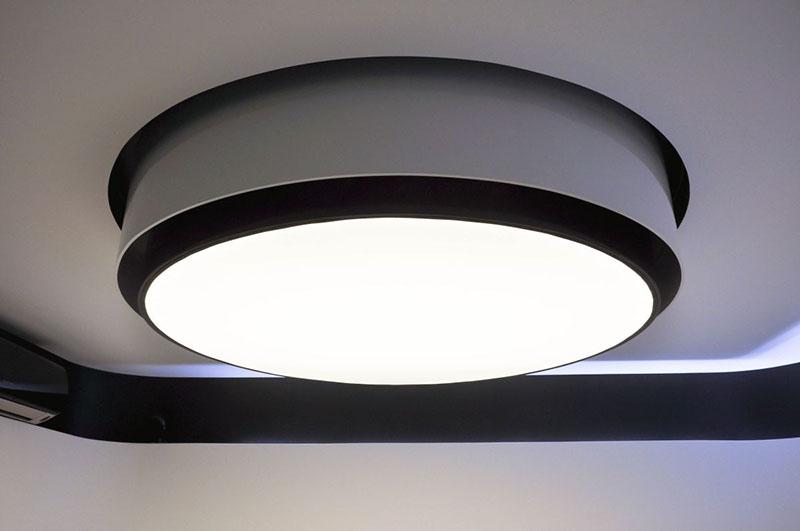 Modern Apartment interior by Jovo Bozhinovski big lamp above sofa