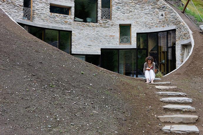 Villa Vals House inside a hill stone way