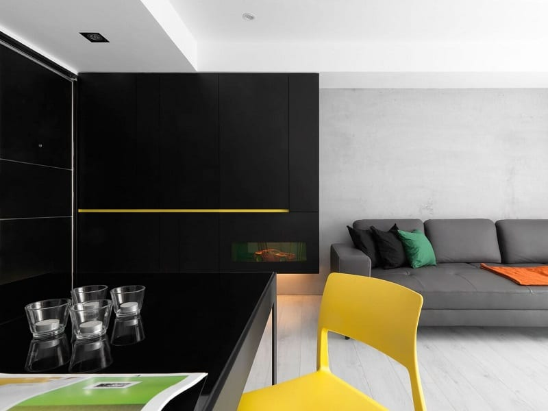 Minimalist black-and-white apartment with yellow accents2