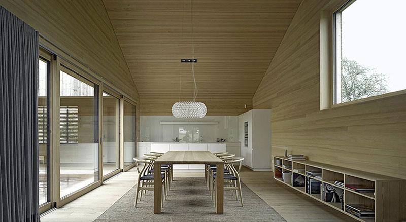house in field by Bernardo Bader 3