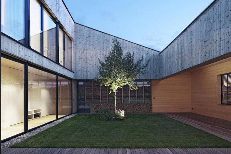 house in field by Bernardo Bader 5