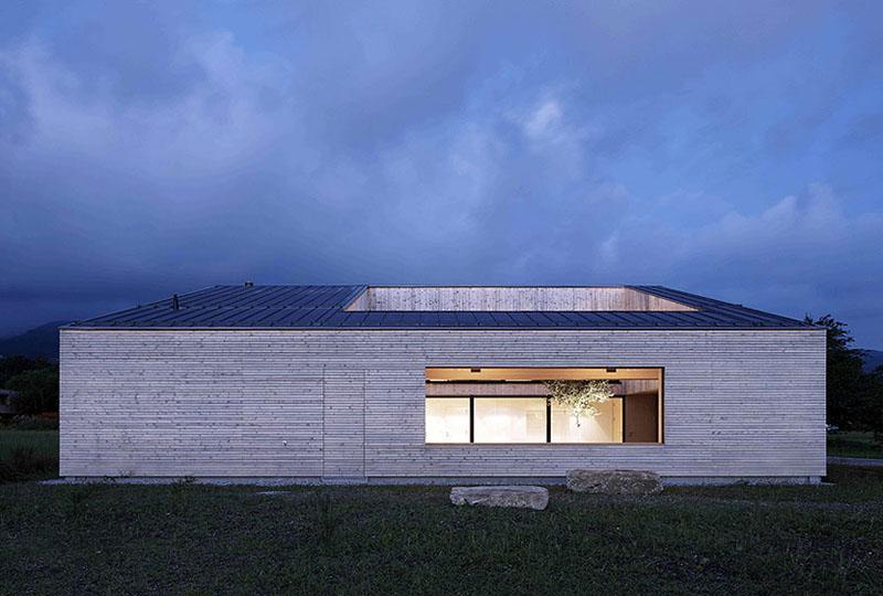 house in field by Bernardo Bader 8