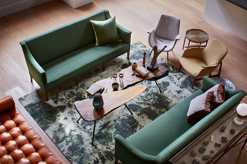 Old courthouse transformed into a refined apartment with vintage furniture and décor