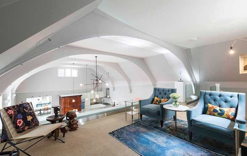 Old courthouse transformed into a refined apartment with vintage furniture and décor13