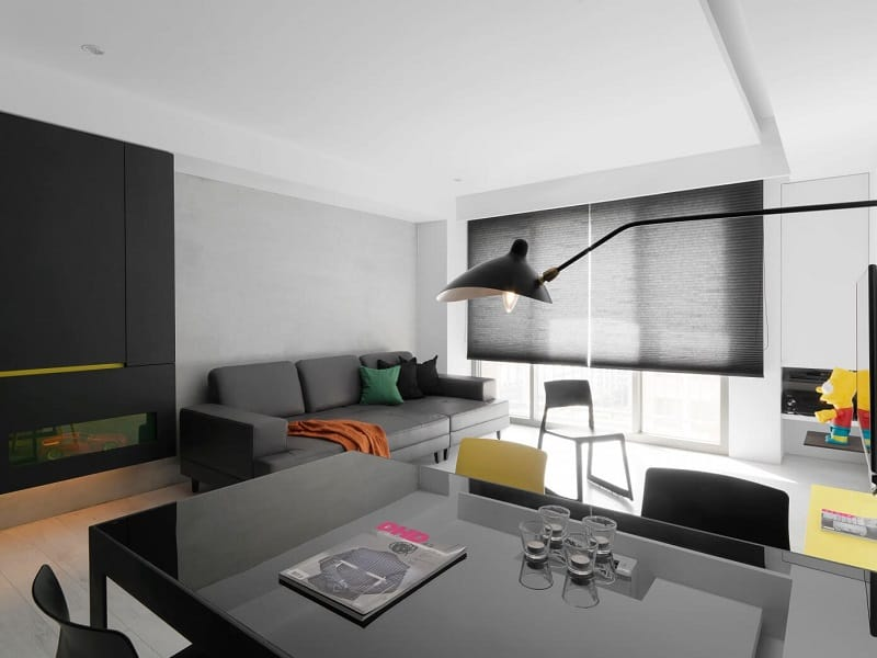 Minimalist black-and-white apartment with yellow accents1