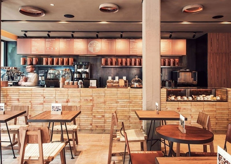 Bright interior with earth colors and wooden elements in the cafe Tierra Garat