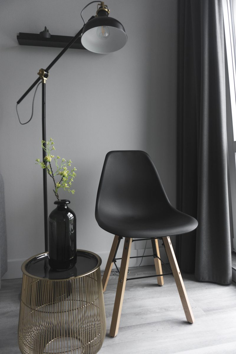 empty chair beside floor lamp