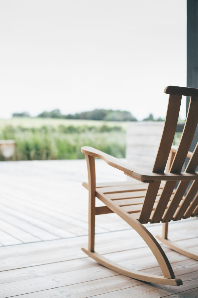 rocking chair on front porch overlooking prairie