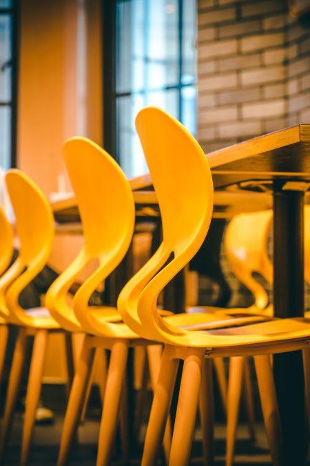 photo of three yellow chairs
