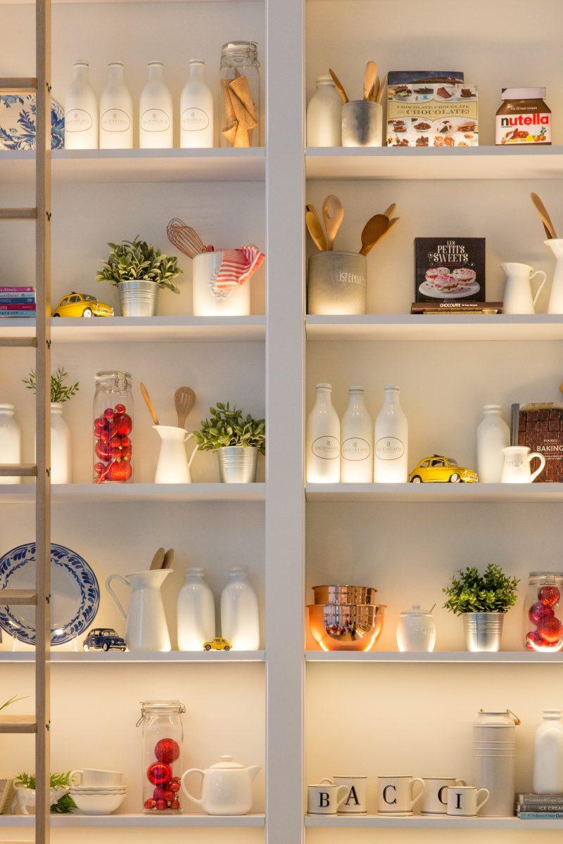 white ceramic bottles on shelf