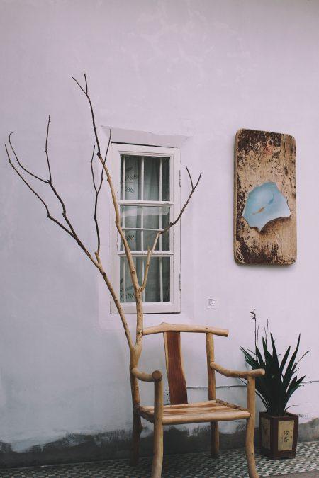 brown wooden armchair outside window