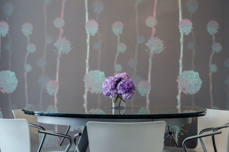 pink and white flowers on white ceramic vase