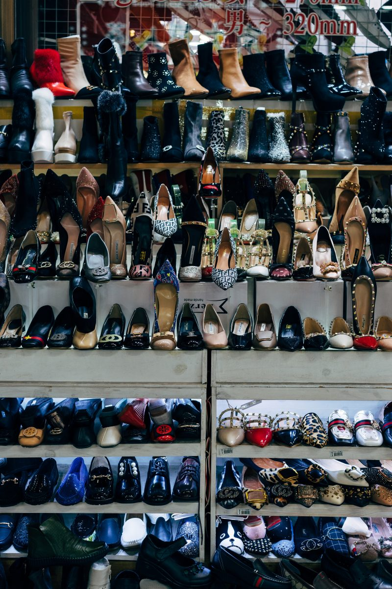 black and white shoes on white shelf