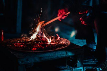 man burning stick during nighttime