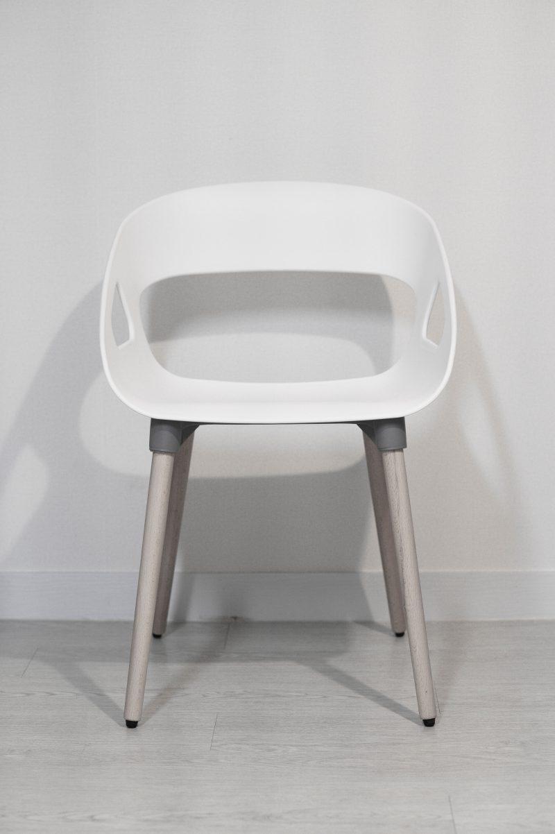 white plastic chair on white floor tiles
