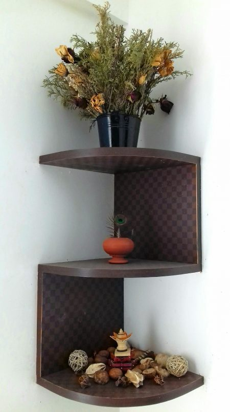 brown wooden shelf and green-leafed plant