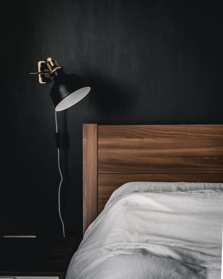 black and white table lamp on brown wooden nightstand