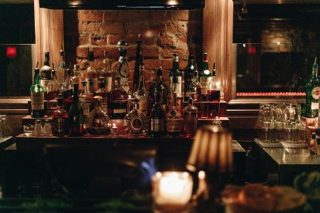 assorted wine bottles in bar