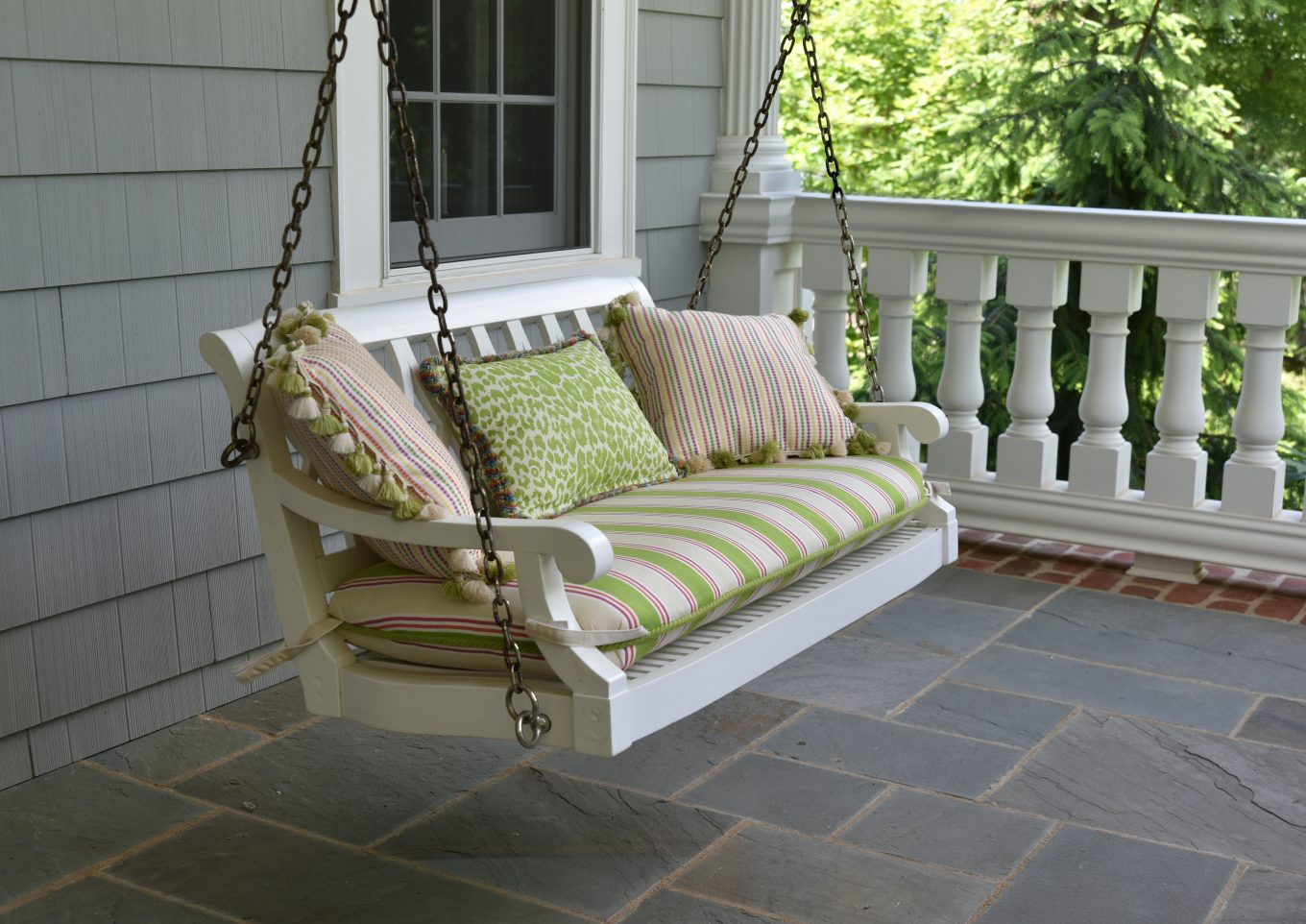 empty swing chair on porch