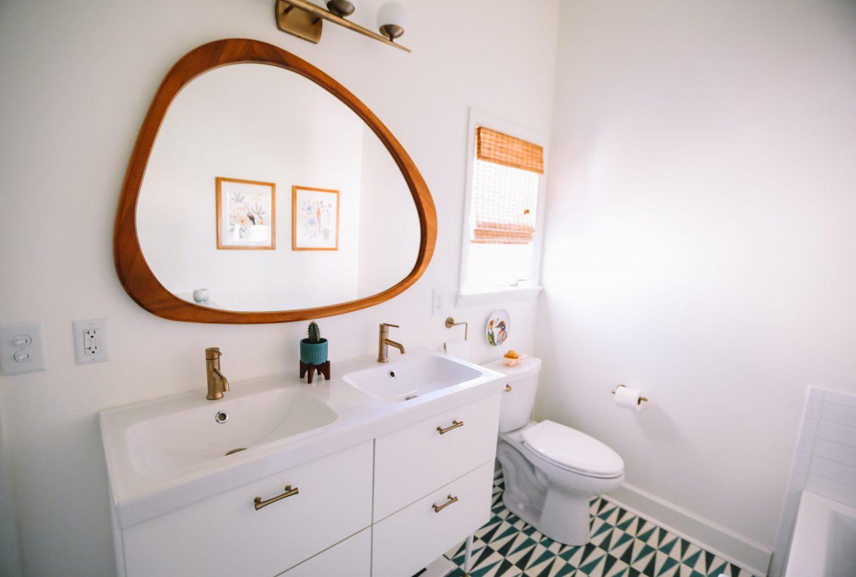 white wooden cabinet sink