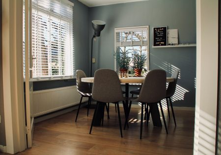round white table across black upright lamp