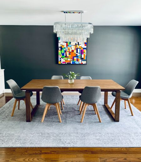 black wooden table with chairs
